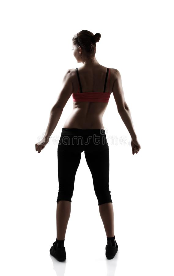 Back view of sport young woman, silhouette studio shot over whit. E background royalty free stock photos