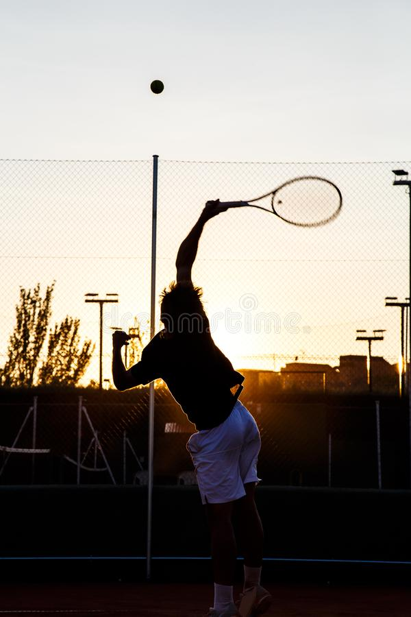Anonymous man playing tennis on court stock photos