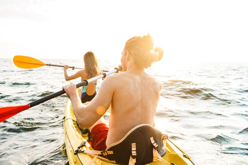 Sporty attractive couple kayaking royalty free stock images