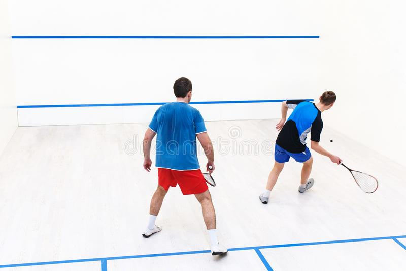 Squash players back view royalty free stock photo