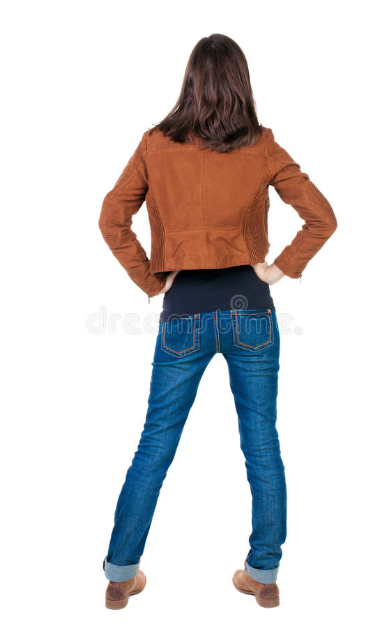Back view of standing young beautiful brunette woman in brown j stock images