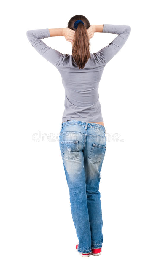 Back view of standing young beautiful brunette woman. stock images
