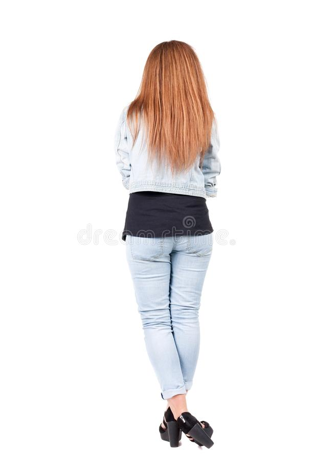 Back view of standing young beautiful redhead woman. stock photography