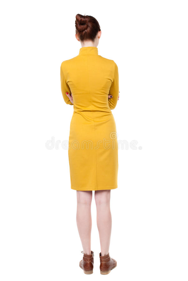 Back view of standing young beautiful woman. girl watching. stock images