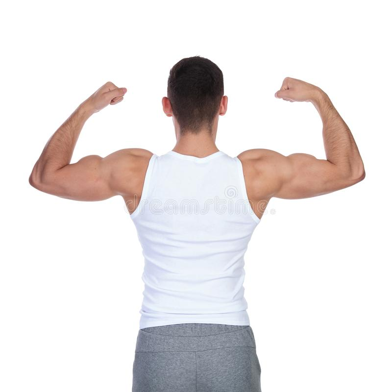 Back view of strong man in undershirt flexing his biceps stock photos