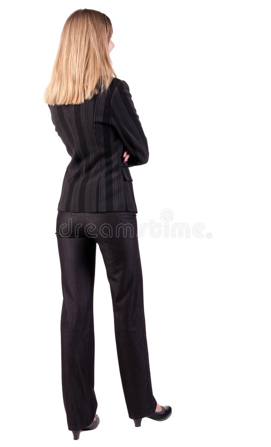 Back view of thoughtful business woman contemplating royalty free stock image