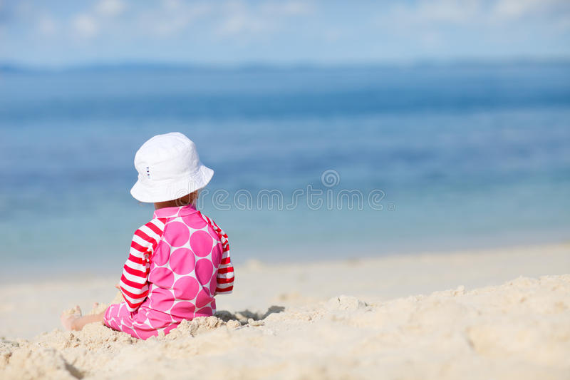 Back view of toddler girl on beach stock photography