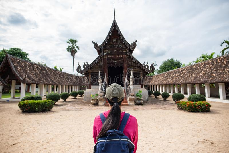 Back view of traveler at temple in Chiangmai,Thailand. Back view of traveler wowan standing at Wat Ton Kwen Wat Inthrawat, ancient temple in Chiang Mai, Thailand stock photography