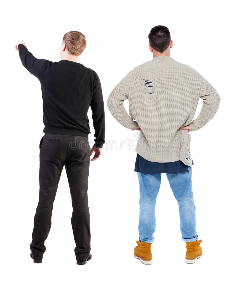 Back view of two man in sweater pointing stock images