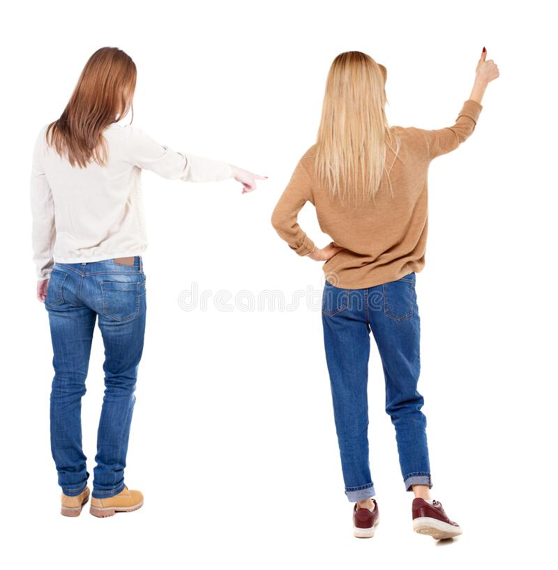 Back view of two pointing young girl in sweater stock photos