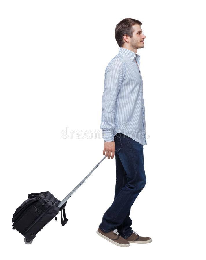 Back view of walking  business man  with suitcase stock images
