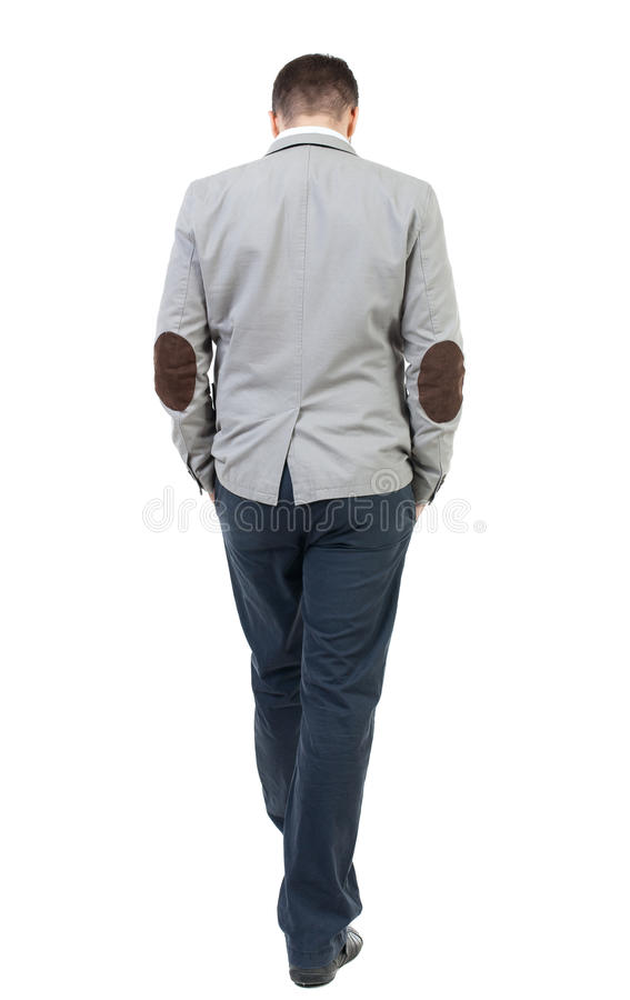 Back view of walking businessman. Rear view people collection. Backside view of person. Isolated over white background. The bearded man in a gray coat walking stock photo