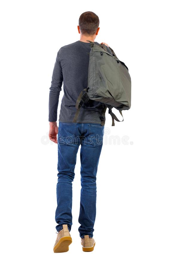 Back view of walking man with green bag stock photos