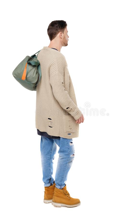 Back view of walking man with green bag. Backside view of person. Rear view people collection. Isolated over white background. The brunette with a large bag stock photo