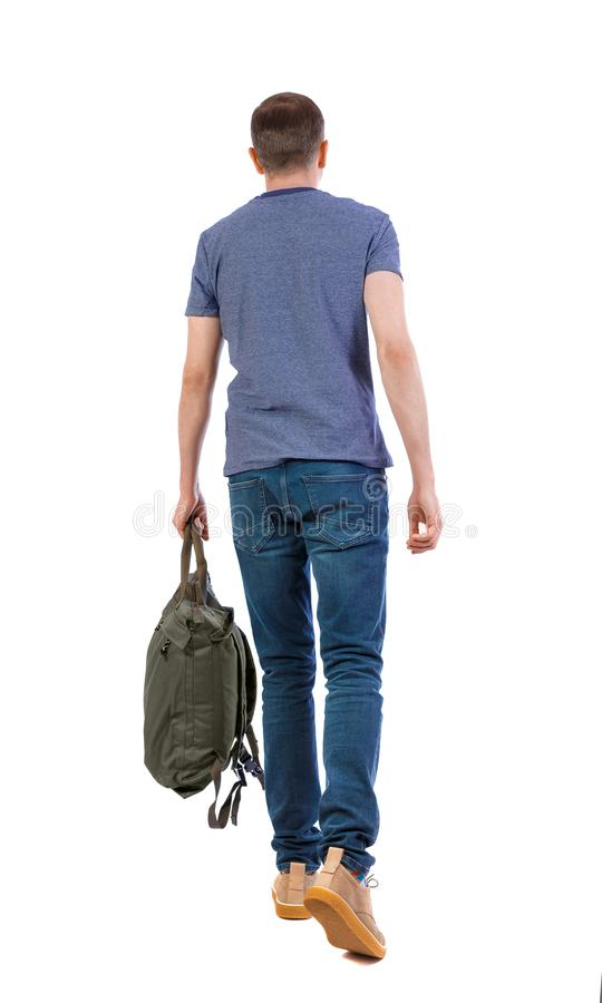 Back view of walking man with green bag stock photo