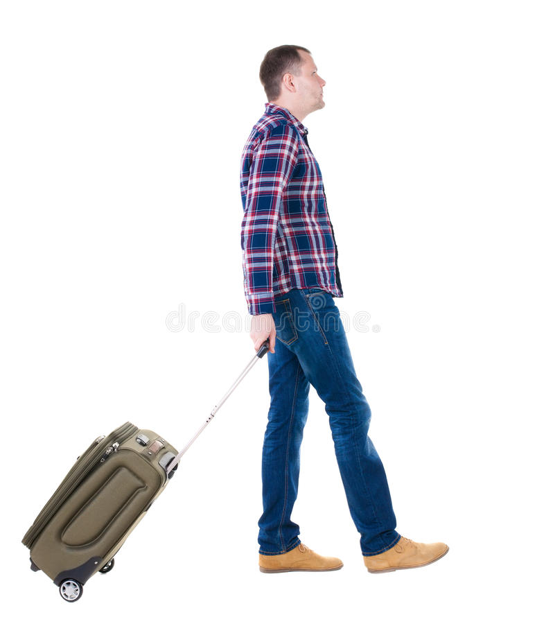 Back view of walking man with suitcase. royalty free stock images