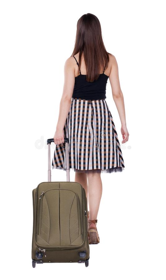 Back view of walking woman with green suitcase. Beautiful brunette girl in motion. backside view of person. Rear view people collection. Isolated over white royalty free stock photos