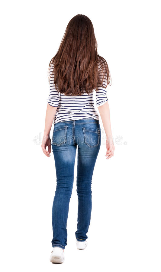 Back view of walking woman in jeans . stock photos
