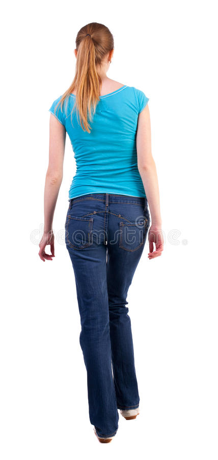Back view of walking woman royalty free stock photo