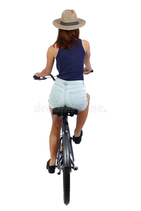 Back view of a woman with a bicycle. royalty free stock images