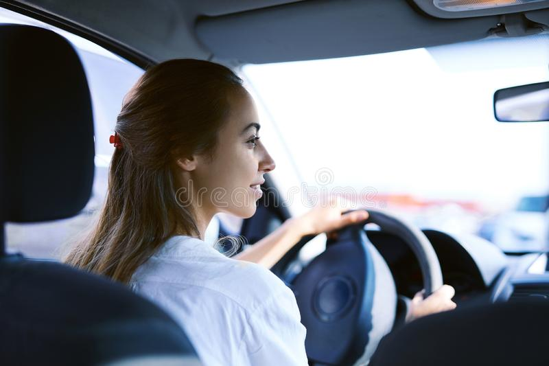 Back view a woman driver in the car stock photography