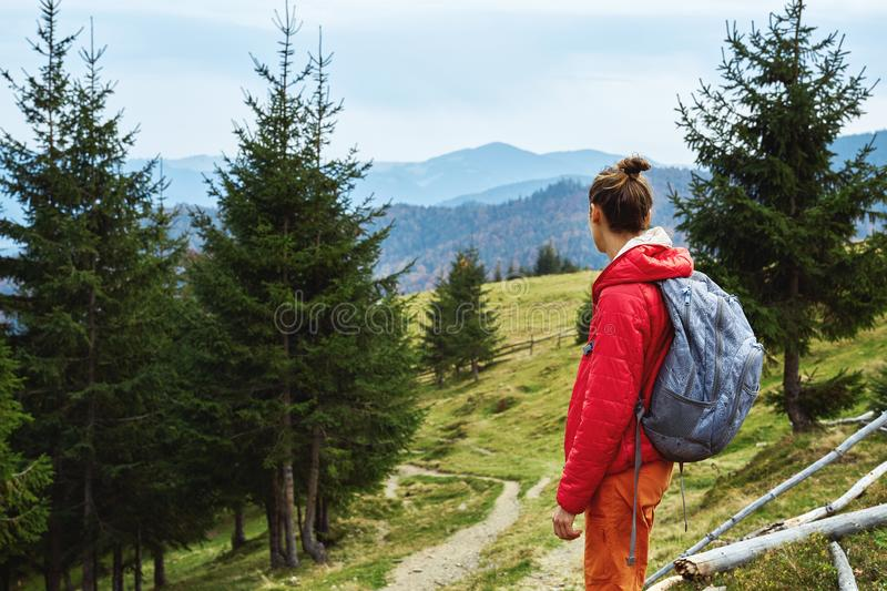 Woman hiker with backpack walking outdoors in mountains royalty free stock images