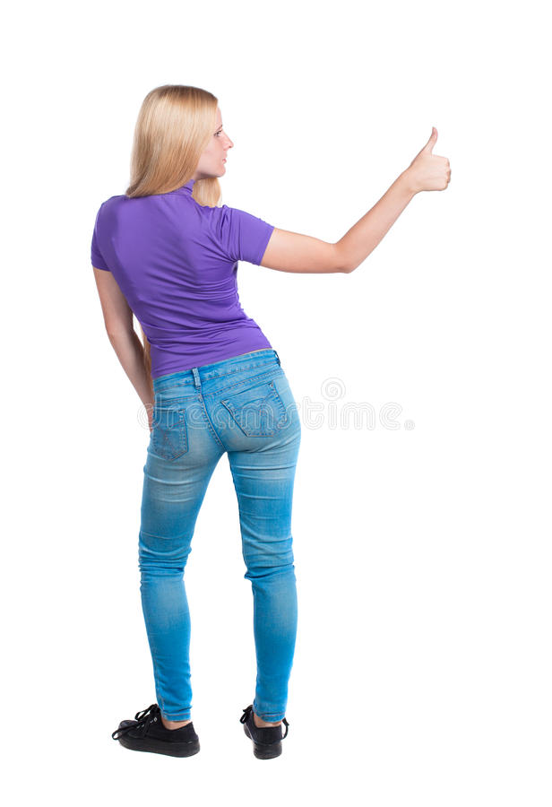 Back view of woman thumbs up. Rear people collection. backside person. Back view of woman thumbs up. Rear view people collection. backside view of person royalty free stock photos