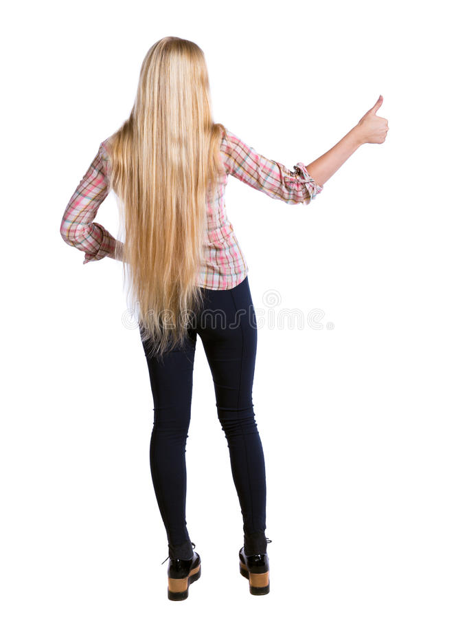 Back view of woman thumbs up. Rear view people collection. backside view of person. Isolated over white background. Long-haired girl shows thumbs up royalty free stock photo