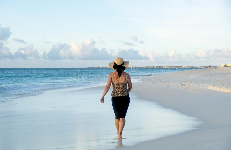 Back View of a Woman Walking Barefoot on a Caribbean Beach 4 stock images
