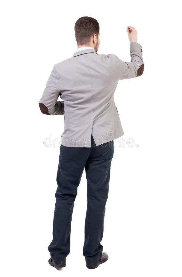 Back view of writing business man in suit. Young in draws. Rear view people collection. backside view of person. Isolated over white background royalty free stock image