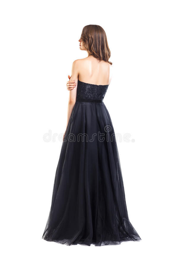 Back view of young beautiful woman in black evening dress stock photo