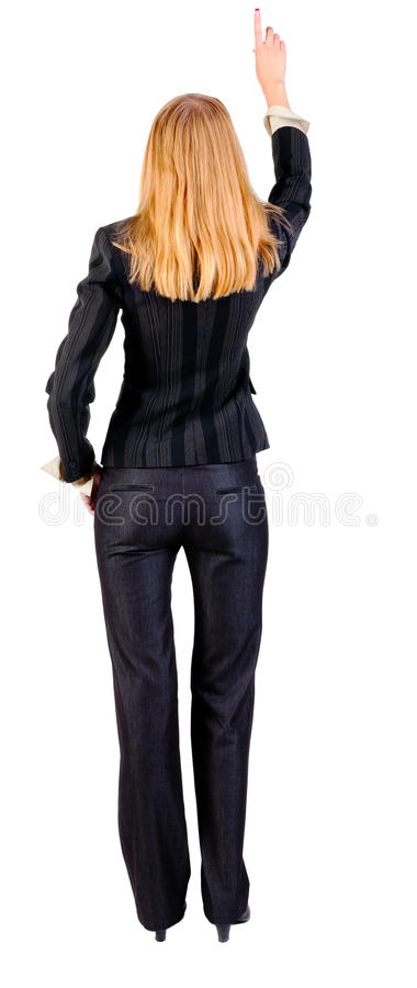 Back view of young blonde business woman pointing royalty free stock photo