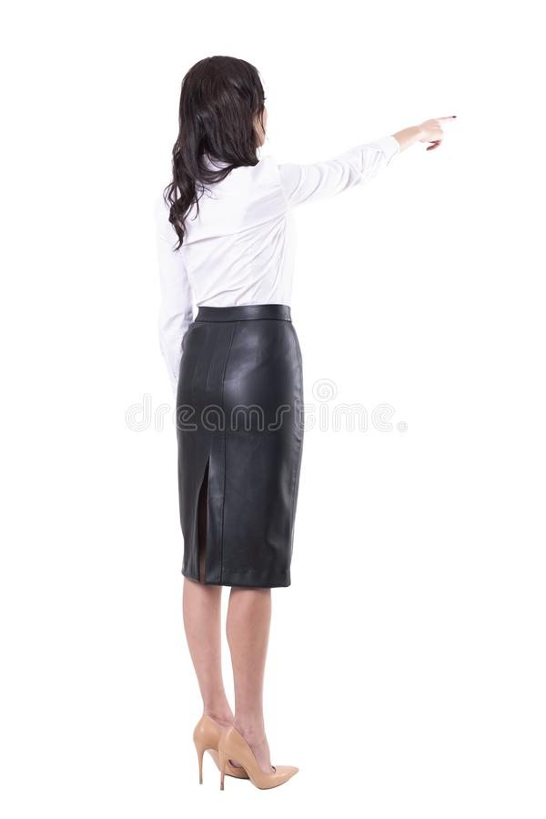 Back view of young business woman pointing finger showing direction or using touch screen. Full body isolated on white background stock photo