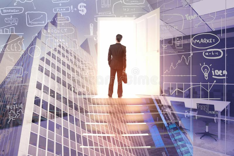 Success and opportunity concept. Back view of young businessman on abstract city background with business sketch hologram. Success and opportunity concept royalty free stock images