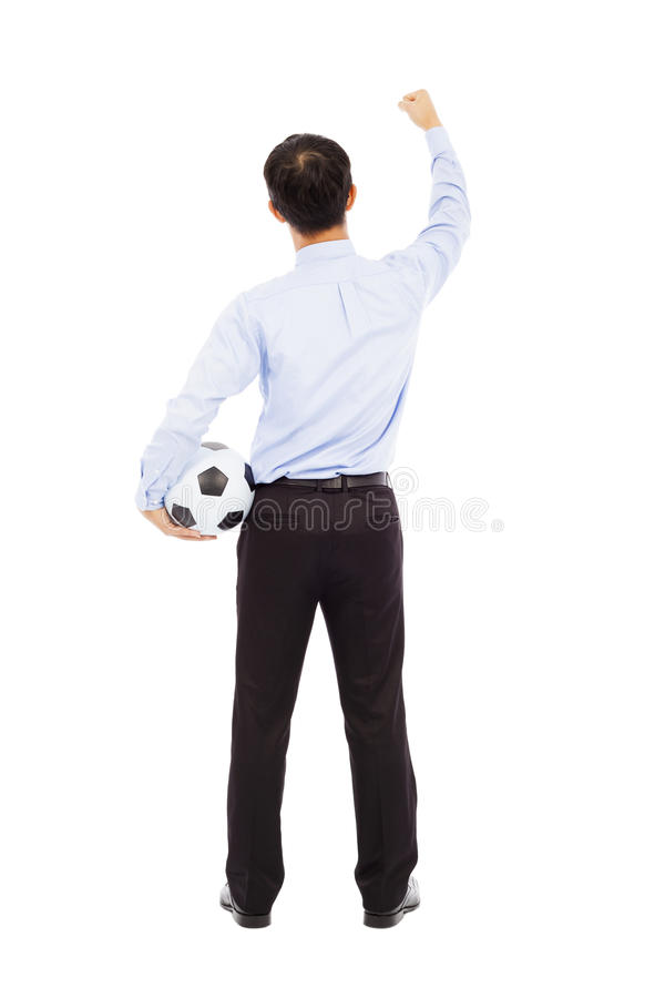 Back View Of Young Businessman Hold A Ball Stock Photo
