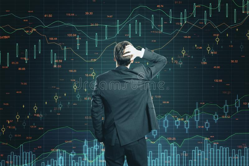 Growth and finance concept. Back view of young businessman looking at dark background with glowing forex chart. Growth and finance concept royalty free stock photos