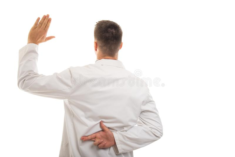Back view of young doctor showing like gesture stock photography