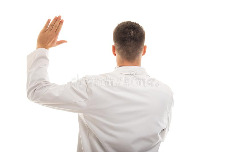 Back view of young doctor taking fake oath gesture stock photos