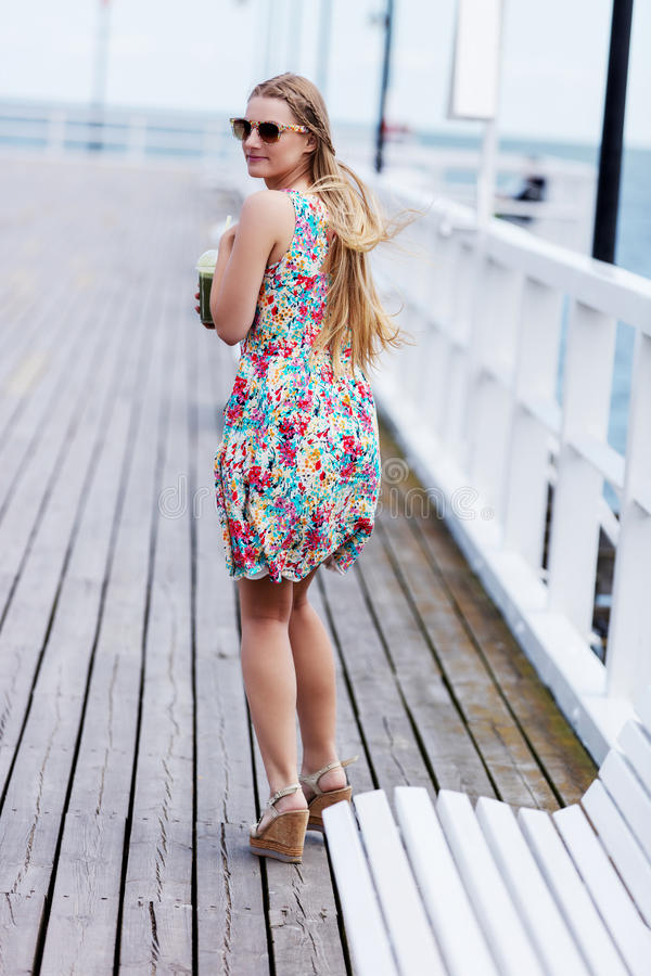Back view of the young female with beautiful blond straight long hair stock photos