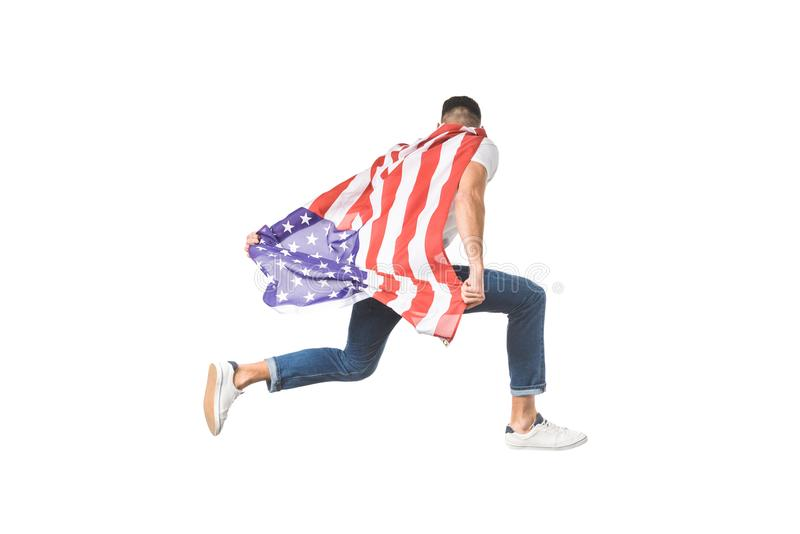 back view of young man with american flag jumping stock images