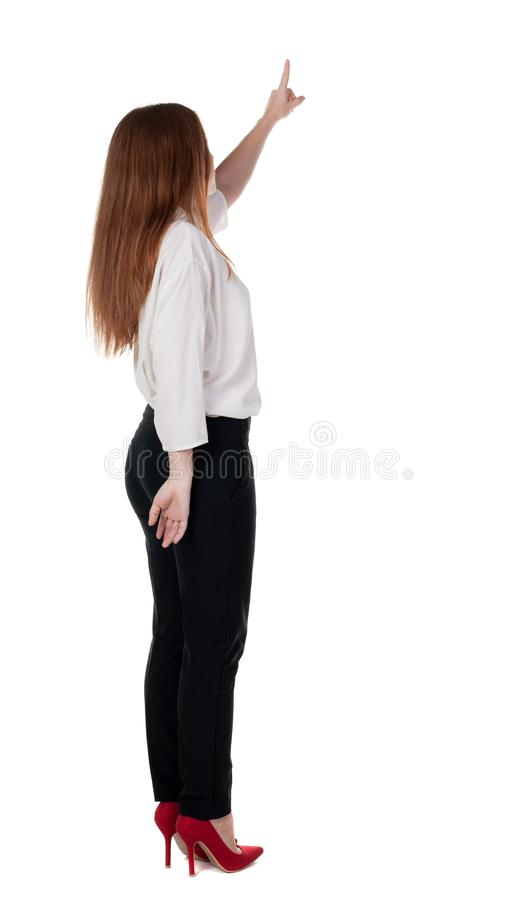 Download Back View Of Young Redhead Business Woman Pointing At Wal Stock Photo - Image: 44469626