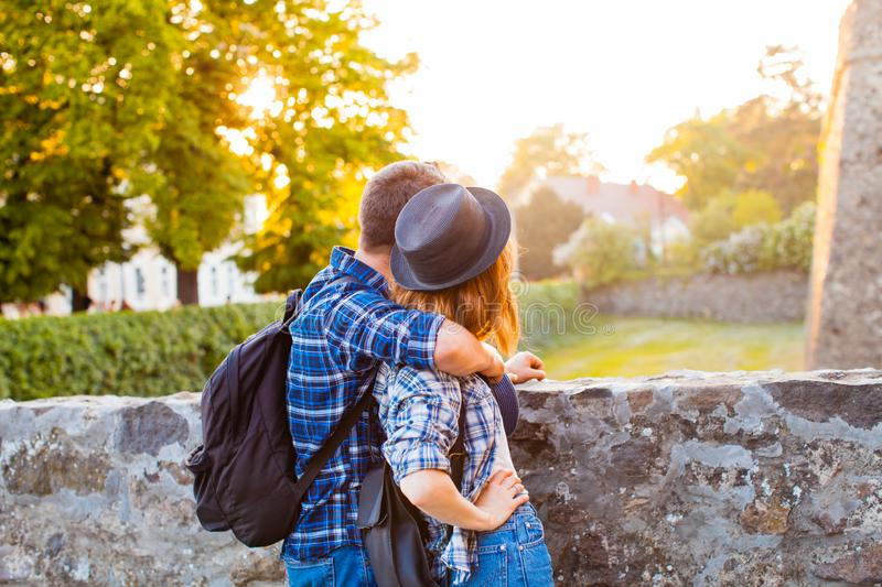 Back view of young stylish couple in hats royalty free stock photography