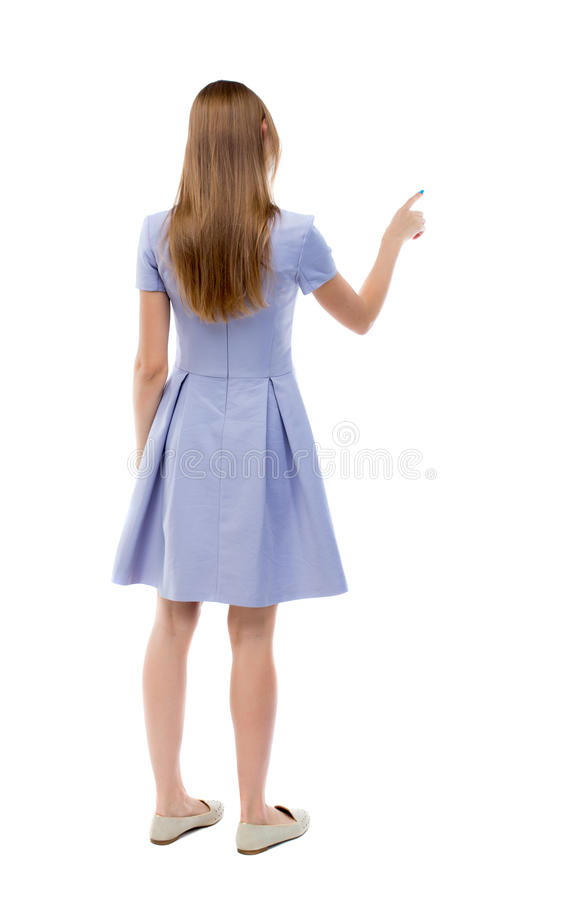 Back view of young woman presses down on something. stock photos