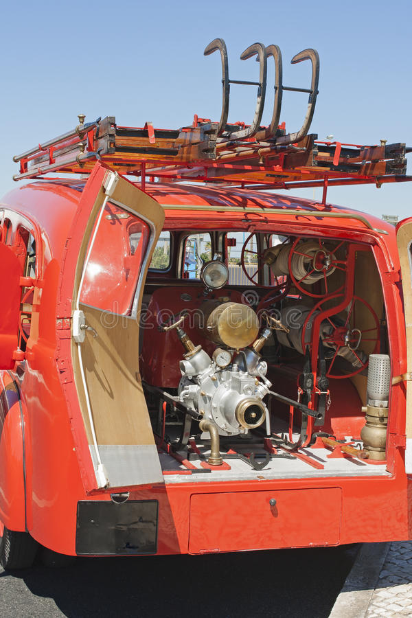 Back vintage firemen truck. Back of a vintage firemen truck with water pump royalty free stock images