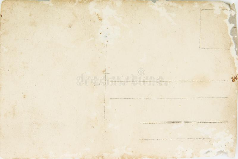 Back of a vintage photo - postcard. Rich stain and paper details stock photography