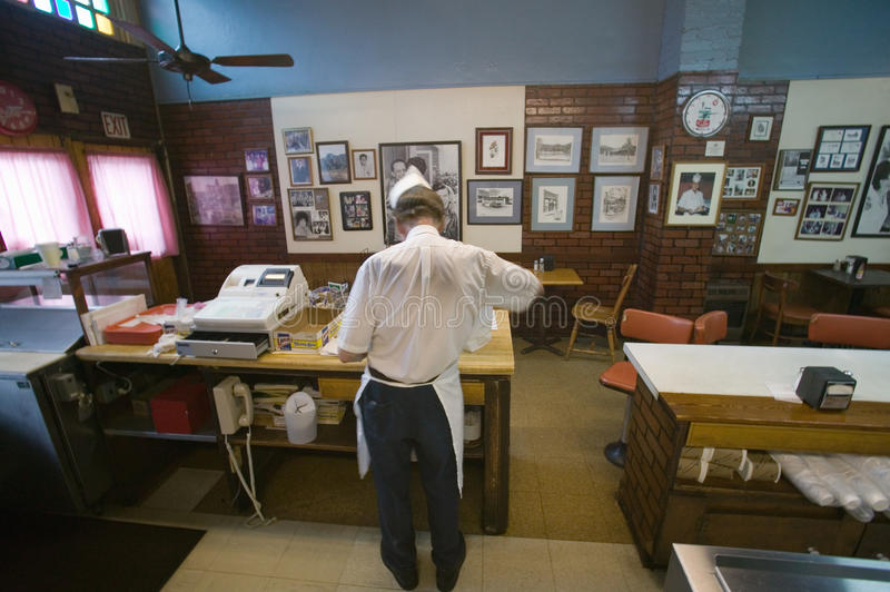 Back of waiter at cash register. In restaurant in Mount Airy, North Carolina, the town featured in �Mayberry RFD� and home of Andy Griffith royalty free stock photo