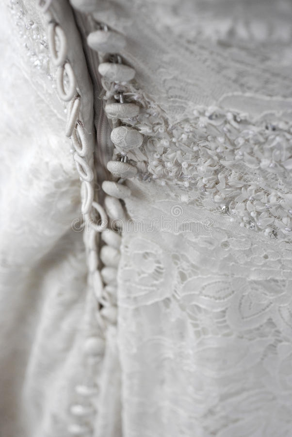 Back of wedding dress. The back buttons of a white wedding dress stock photo
