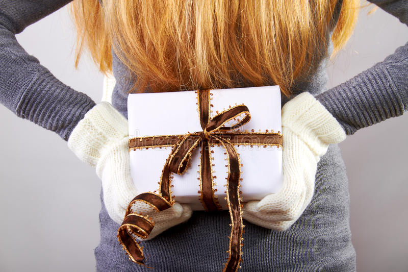 Back of a woman with christmas gift stock images