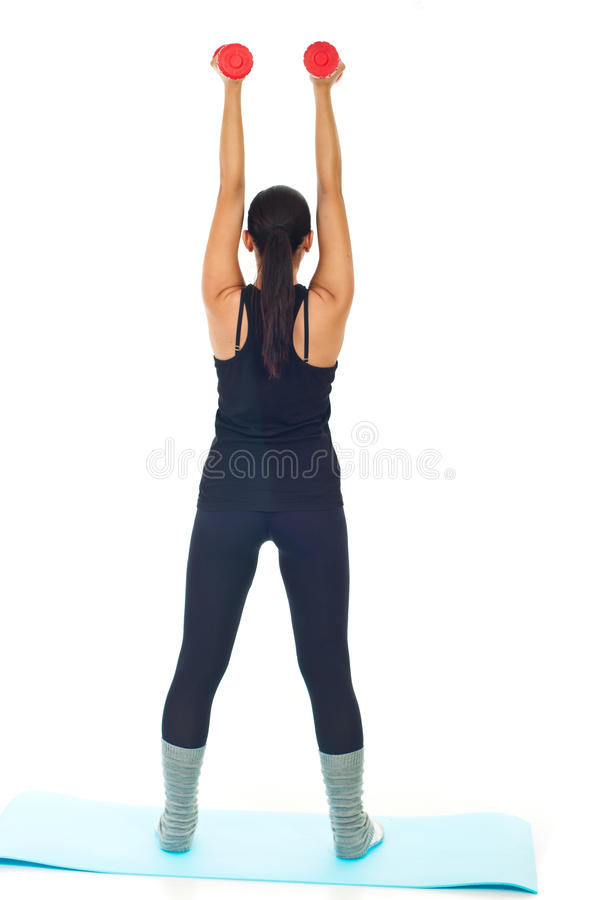 Back of woman lifting barbell stock photo
