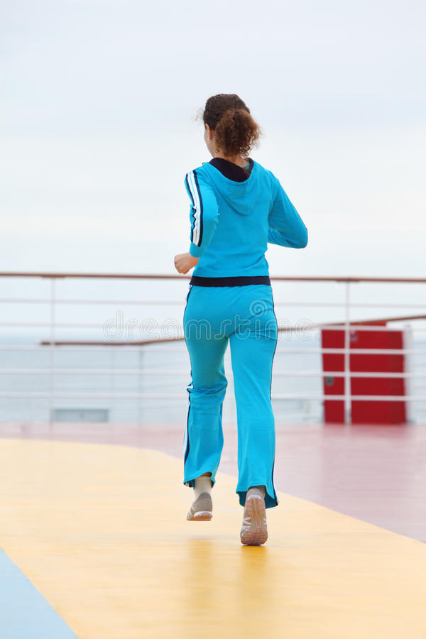 Back of woman running on cruise liner deck stock photos